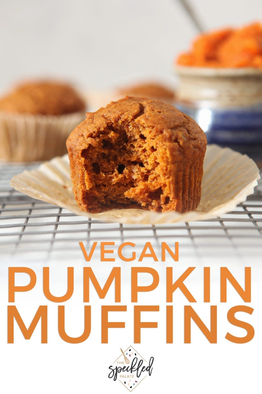 Close up of a Vegan Pumpkin Muffin on a cooling rack, with text