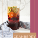 Pinterest image for Citrus Cranberry Sangria, showing a pitcher full of the sangria and text