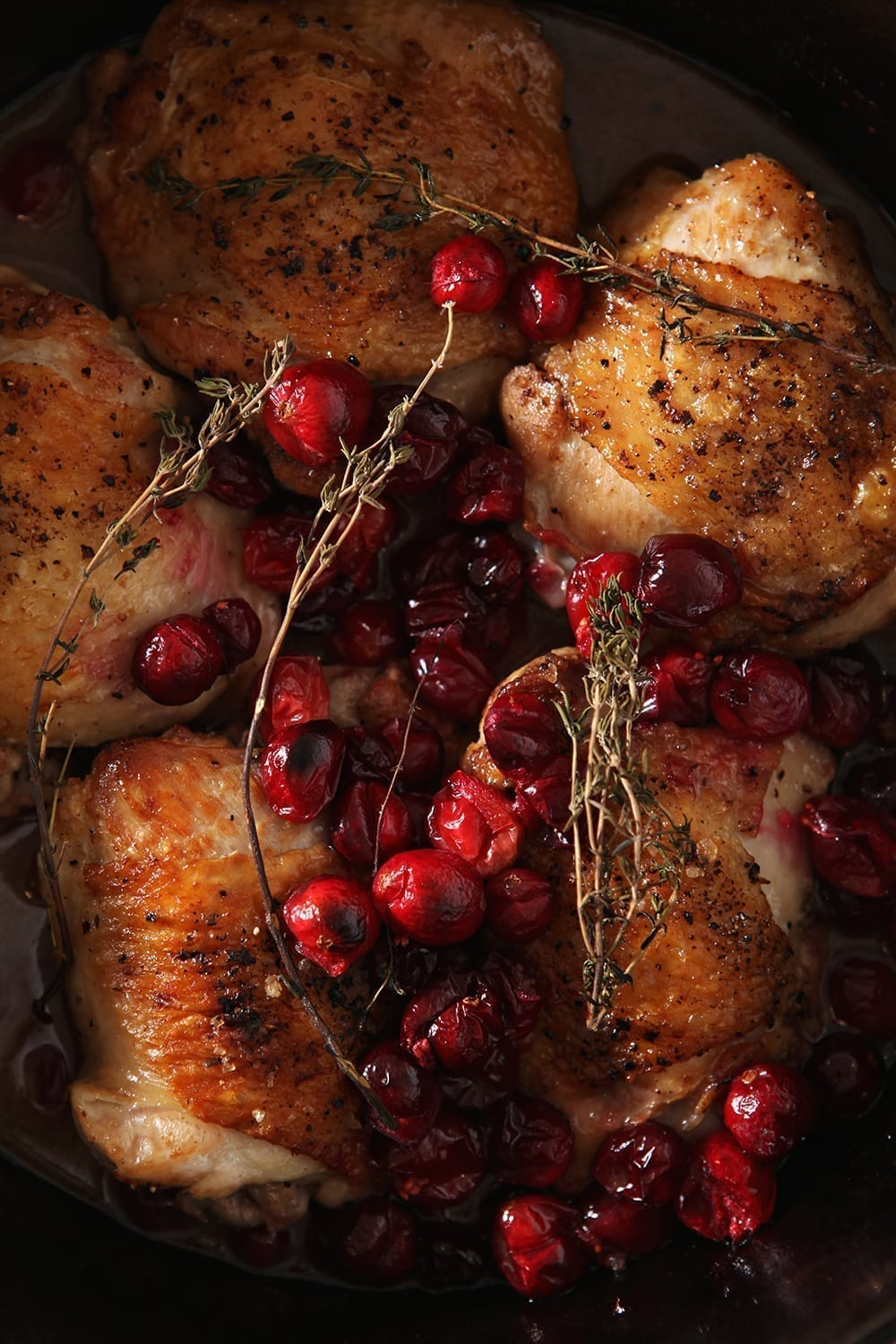 Close up of the Cranberry Chicken Thighs in the skillet, after baking