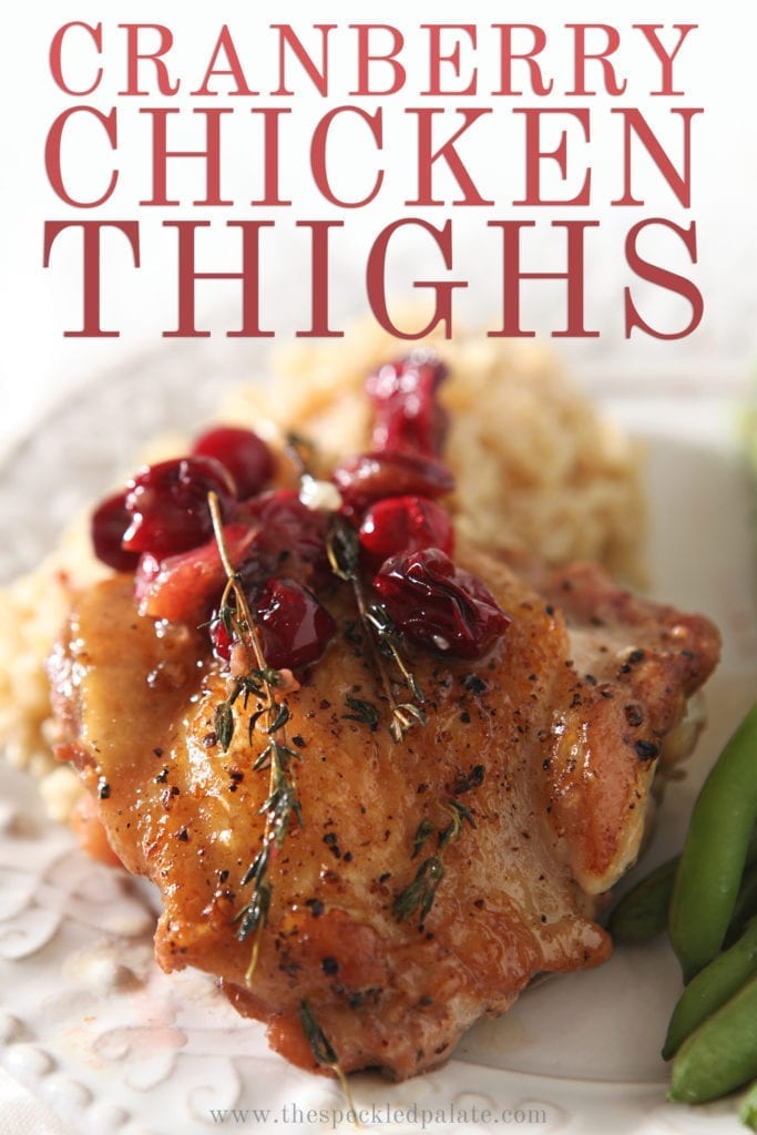 Close up of a Cranberry Chicken Thigh on a plate, with Pinterest text