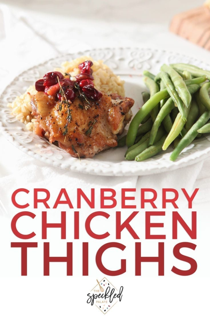 Bake Cranberry Chicken Thighs for a fancy-feeling and wonderfully delicious centerpiece to any dinner. Made with fresh cranberries, these baked chicken thighs are perfect for a weeknight meal or a dinner party with friends. #easyentertaining #speckledpalate