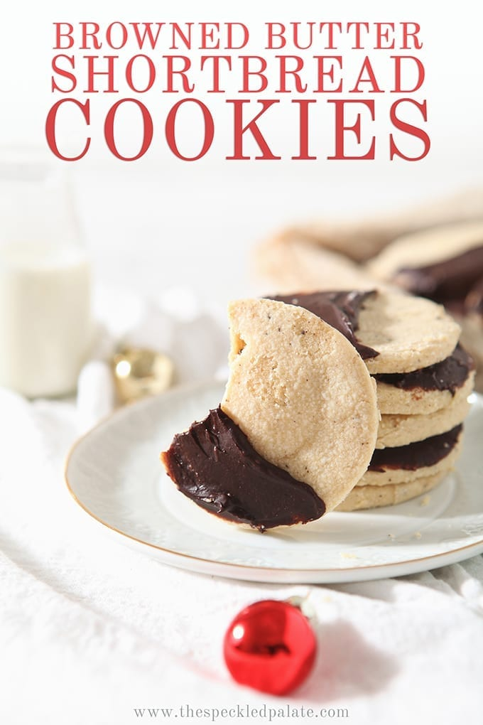 A bitten into Shortbread Brown Butter Cookies sits on a white plate, with Pinterest text