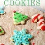 Decorated and colorful sugar cookies on a brown paper, with Pinterest text