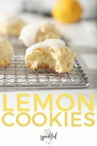 Close up of a bitten into Lemon Drop Cookie on a metal tray, with Pinterest text