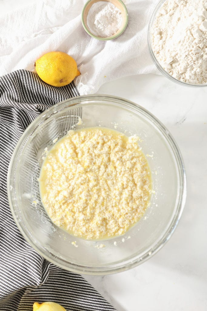 Lemon cookie dough wet ingredients, mixed, are shown in a bowl form above