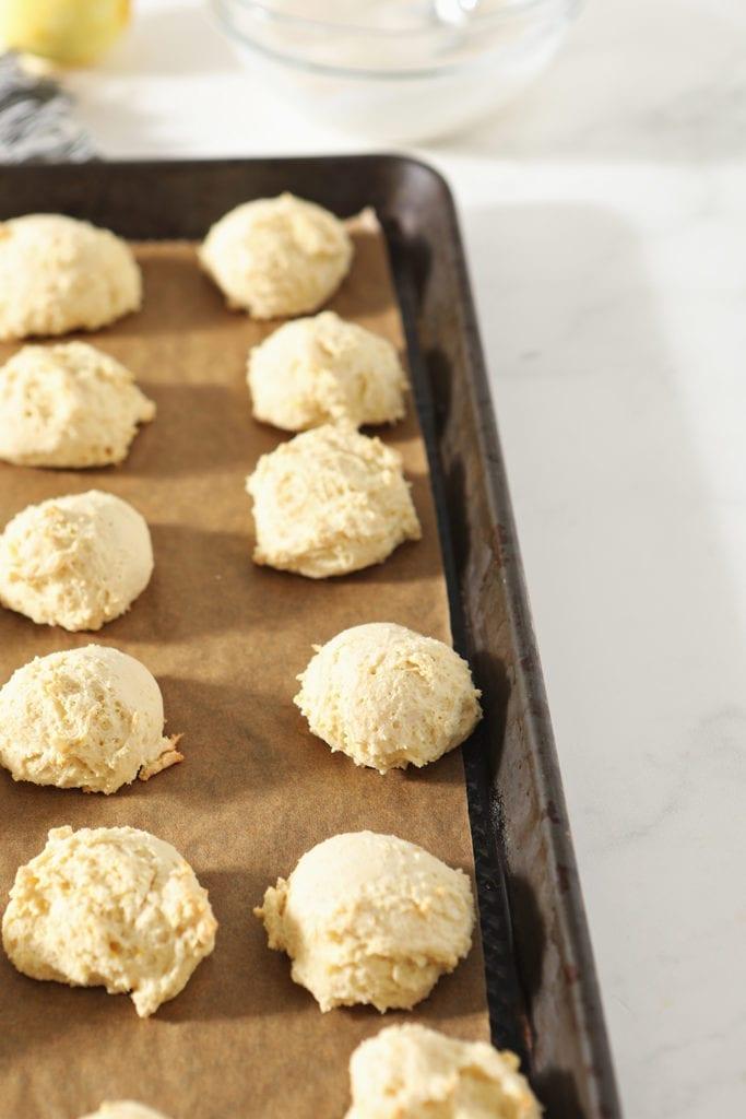 Lemon Drop Cookies on a baking sheet, after baking