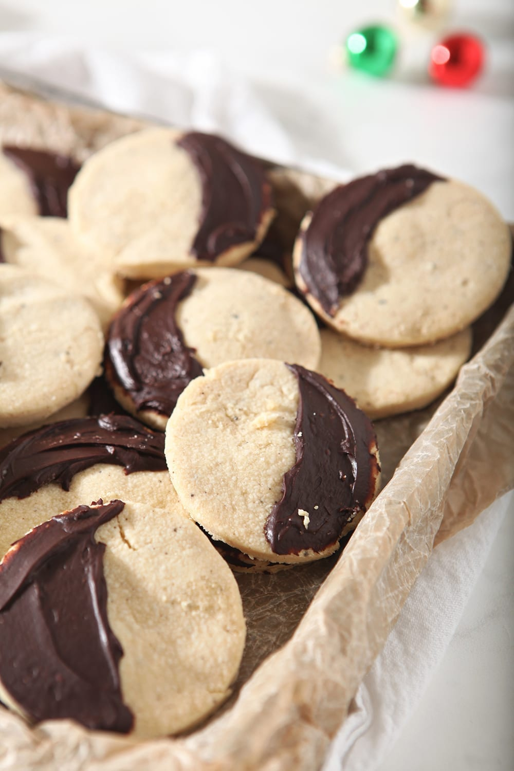 A tray full of Shortbread Brown Butter Cookies with ganache covering half of the cookies