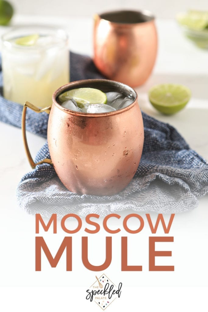 Three Moscow Mules are shown on a blue towel, with Pinterest text