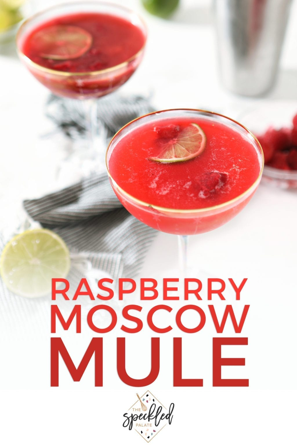 Pinterest image of two raspberry mules, garnished with limes and raspberries, and Pinterest text