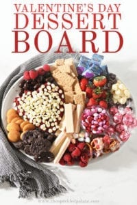 A white platter holds a dessert board, shown from above with Pinterest text