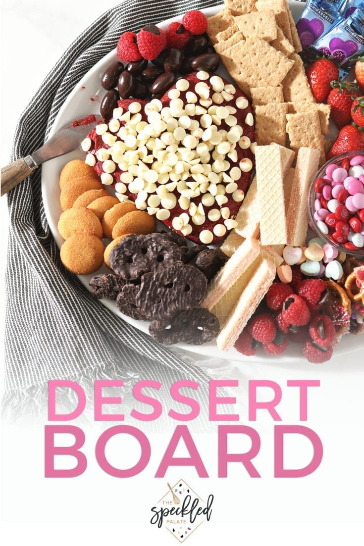 Surprise someone you love with a dessert board! Including a homemade Red Velvet Cake Ball, dippers chocolate-covered candies, fruits and more, this dessert tray is easily customizable and perfect for sharing! #freakyfridayrecipes #datenight #valentinesday #speckledpalate