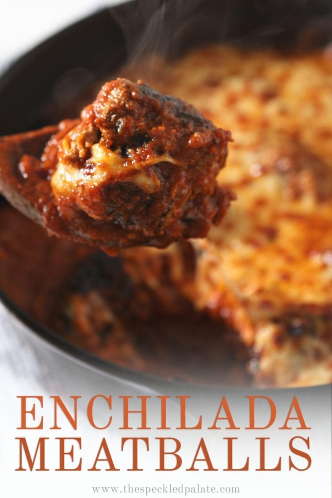 A spoon lifts an Enchilada Meatball out of the pan, with Pinterest text
