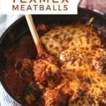 A skillet holds Enchilada Meatballs, with Pinterest text