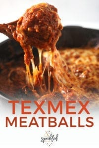 A spoon pulls a cheesy meatball from the pan, with Pinterest text