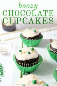 Chocolate Guinness Cupcakes are displayed on a marble board, with Pinterest text