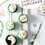 Overhead of several cupcakes decorated for St. Patrick's Day, with Pinterest text