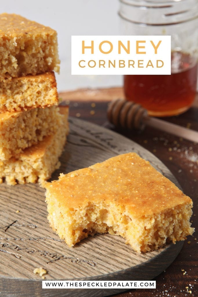 A piece of Honey Cornbread, with other slices, has a bite taken out of it, with Pinterest text