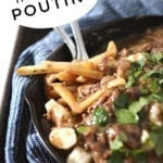 Close up of a skillet of Beef Poutine Fries and Gravy with Pinterest text