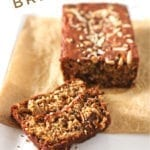 Two slices and a loaf of eggless Banana Bread sit on a white platter with bananas in the background, with Pinterest text