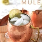 Close up of a brown platter holds two Mexican Mules, with Pinterest text