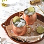 A brown platter holds two Mexican Mules, with Pinterest text