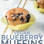 Close up of a Vegan Blueberry Muffin on a marble platter, with Pinterest text