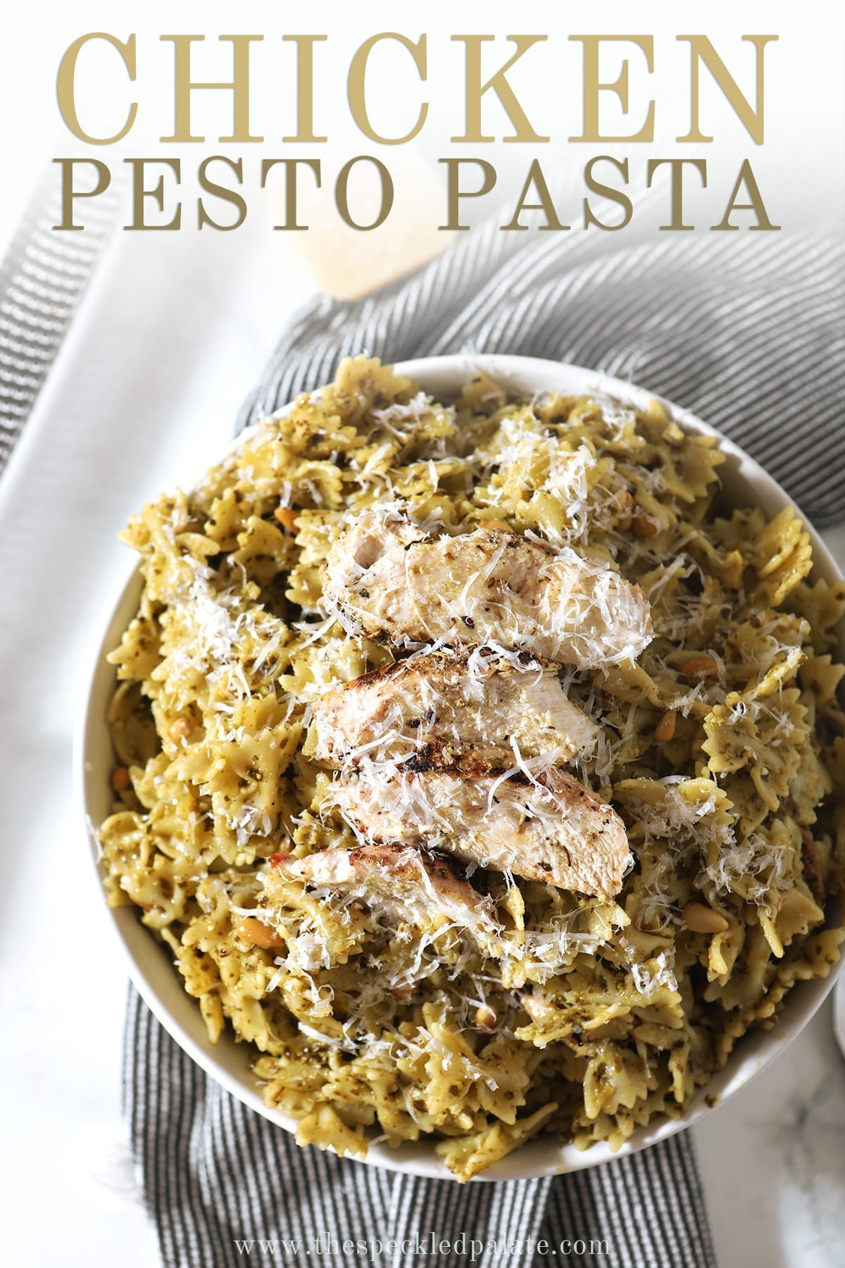 A bowl of Chicken Pesto Pasta from the side, with Pinterest text