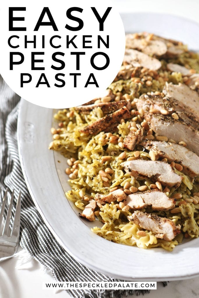 A platter holds the Chicken Pesto Pasta, before serving, with Pinterest text