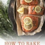 """Baked salmon on a silver platter garnished with lemon rounds and surrounded by fresh dill with Pinterest text stating, """"How to Bake Salmon in the oven with skin on"""""""
