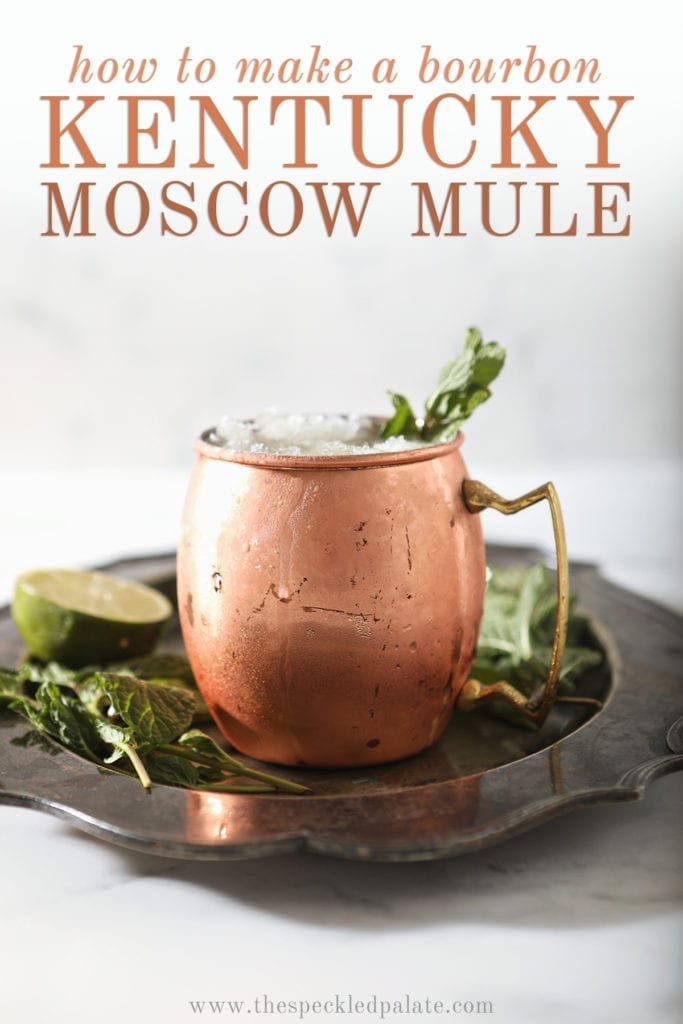 A copper mug holds a Kentucky Mule, with Pinterest text