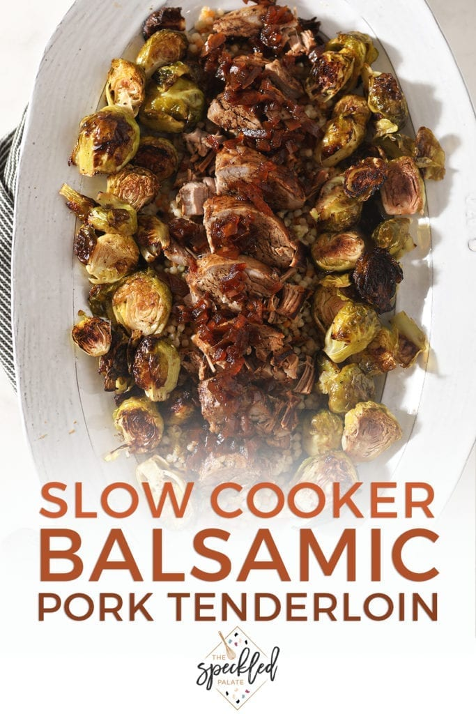 Sliced pork tenderloin and brussels sprouts on a large white platter, with text that says 'Slow Cooker Balsamic Pork Tenderloin'