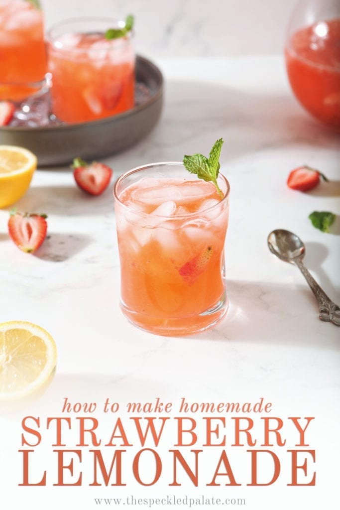A glass of Strawberry Lemonade is shown with fresh strawberries and lemon slices with text at the bottom