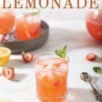A glass of Strawberry Lemonade is shown with fresh strawberries and lemon slices with text