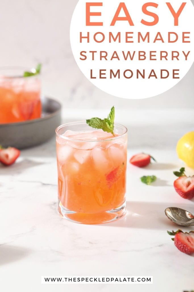 A glass of Strawberry Lemonade is shown with fresh strawberries and lemon slices with a circle of text at the top