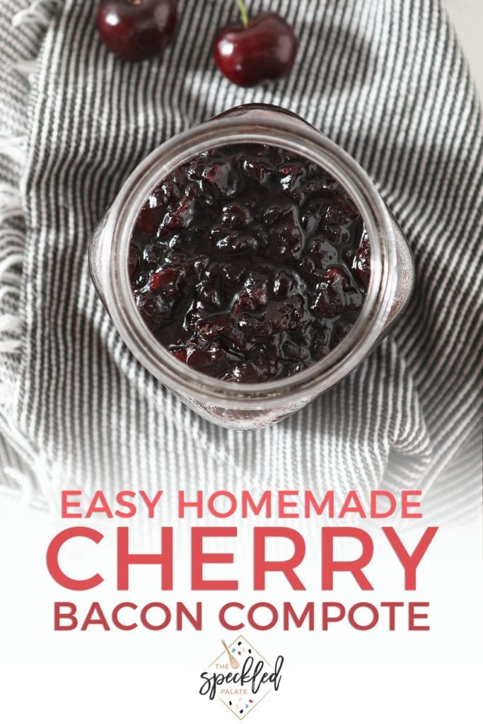 "A jar of Bacon Cherry Compote from above on a grey and white striped towel with text ""easy homemade cherry bacon compote"""