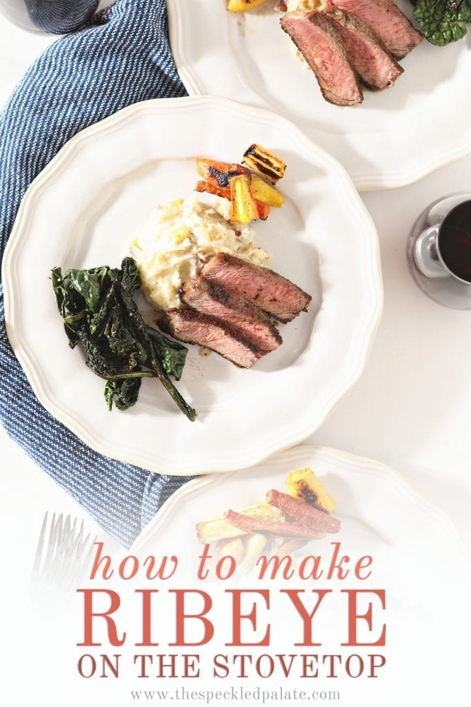 Overhead of three white plates holding sliced steak with potatoes, greens and carrots with text 'how to make ribeye on the stovetop'
