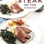 "Two plates hold steak slices with greens, potatoes and carrots with text ""easy cast iron skillet steak on the stovetop"""