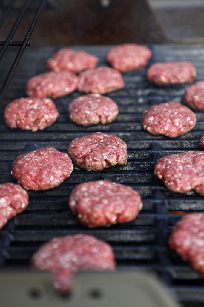 hamburger sliders on a grill