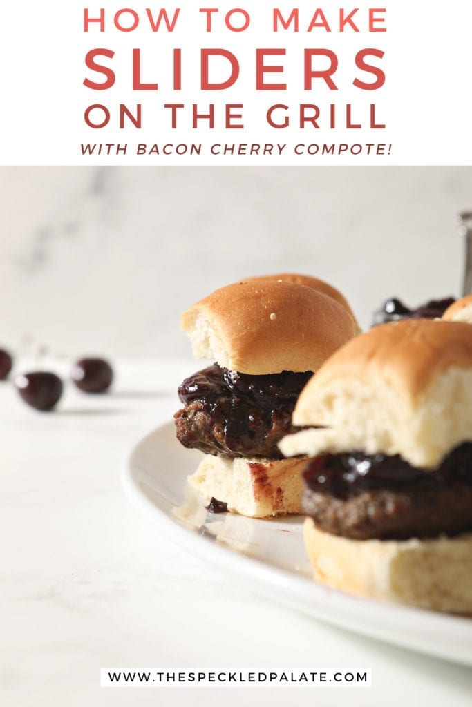 "Hamburger sliders with Bacon Cherry Compote sit on a white platter before serving with text ""how to make sliders on the grill with bacon cherry compote"""