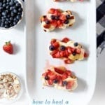 """Blueberry and strawberry-topped bread on a white platter with the text """"how to host a barbecue come see our tips tricks and menu ideas"""""""