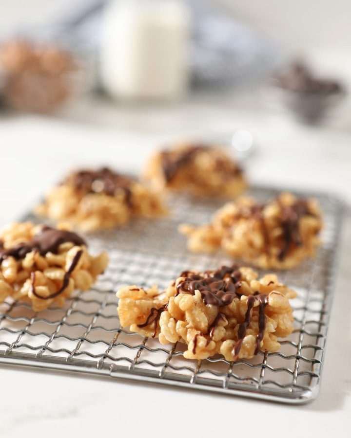 Chocolate Peanut Butter No Bake Cookies sit on a silver grate on a marble surface before eating