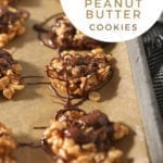 """No Bake Peanut Butter Cookies drizzled with chocolate and butterscotch on a baking sheet with the text """"easy no bake peanut butter cookies"""""""