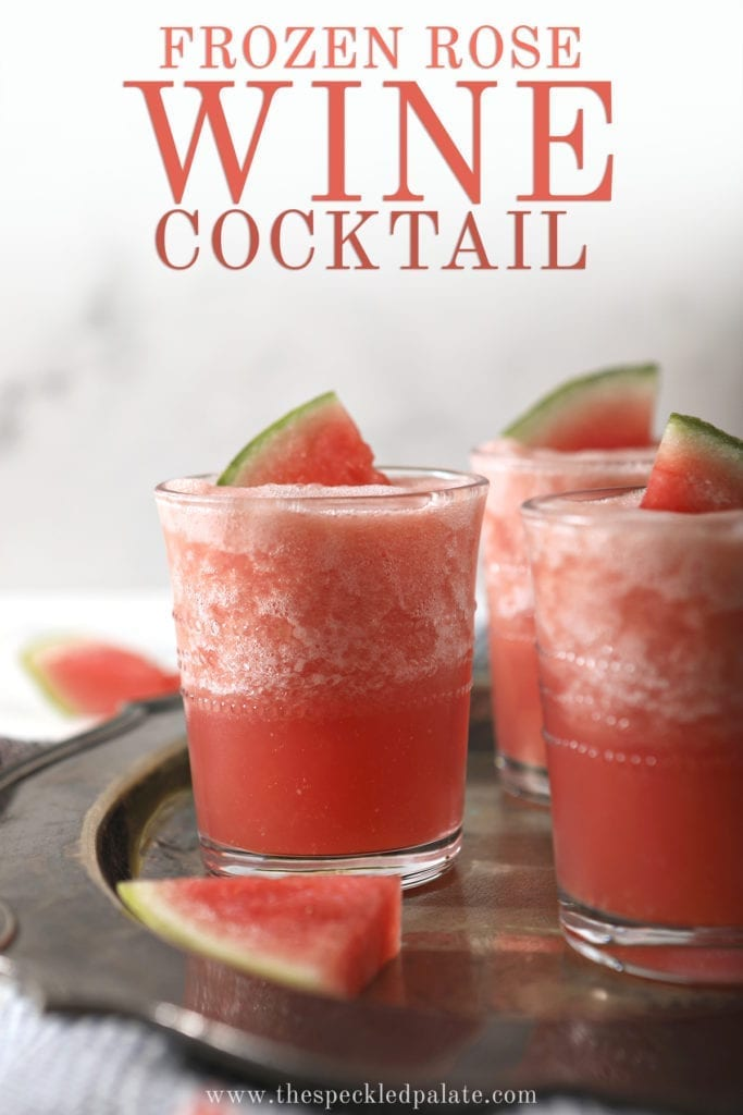 "Three glasses holding pink slushy Watermelon Froses garnished with watermelon wedges on a silver platter, with text saying ""Frozen Rose Wine Cocktail"""