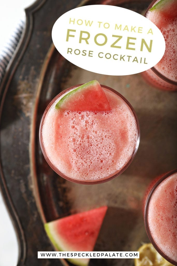 "Overhead of a slushy pink drink inside three glasses, garnished with watermelon, on a silver platter, with text stating, ""How to make frozen rose cocktail"""