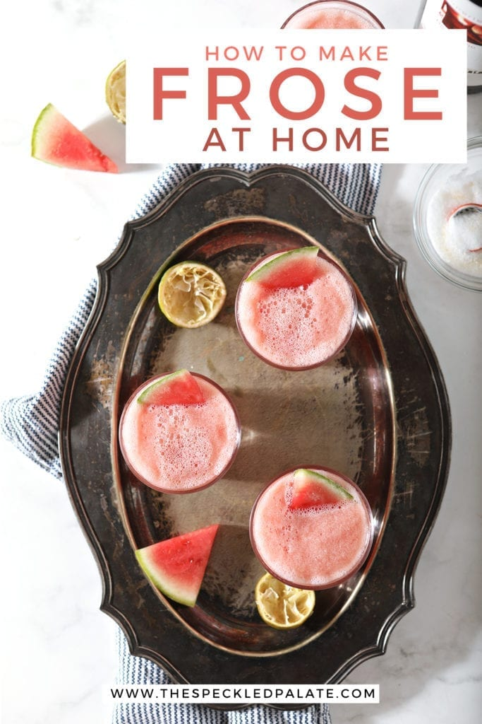 "A silver tray holds three pink drinks garnished with watermelon wedges on top of a blue towel on marble, with text saying, ""How to Make Frose at Home'"