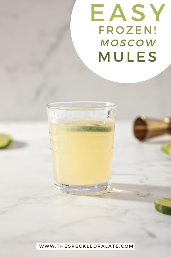 """A glass of a Frozen Mule sits on a marble counter with the text """"Easy Frozen! Moscow Mules"""""""