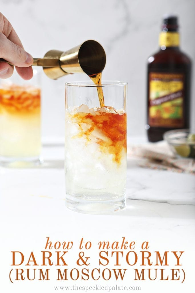 A jigger pours dark rum into a glass with ginger beer with the text 'how to make a dark & stormy (rum moscow mule)'