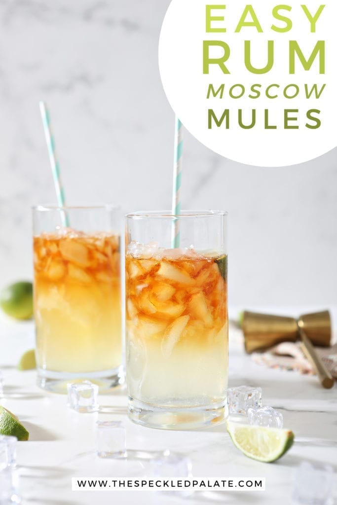 Two Dark and Stormy Drinks sit on marble surrounded by ice cubes, lime wedges and a gold jigger with the text 'easy rum moscow mules'