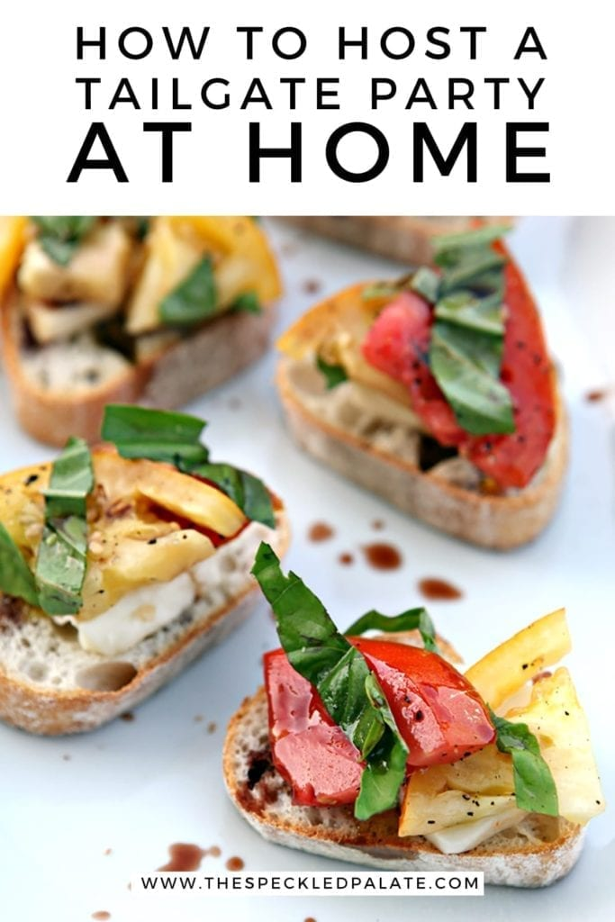 Colorful tomato bruschetta garnished with basil and balsamic vinegar with the text 'how to host a tailgate party at home'