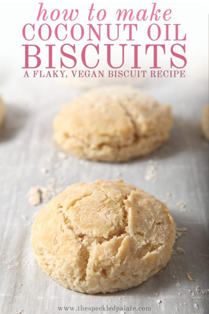 Vegan biscuits on a baking sheet after baking with the text 'how to make coconut oil biscuits. a flaky, vegan biscuit recipe'